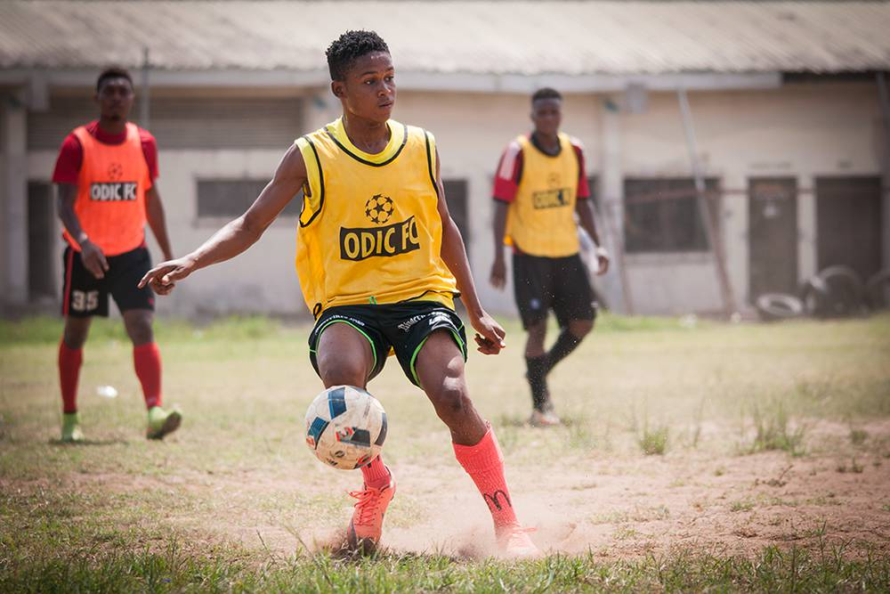 A young boy participates in a game during a tournament organized by two football academies based in Satellite Town, Lagos. During such tournaments, young football hopefuls have a chance to showcase their talents to scouts from Europe hoping to earn a move to a European club. Lagos, Spring 2016. (Photo Paweł Banaś)