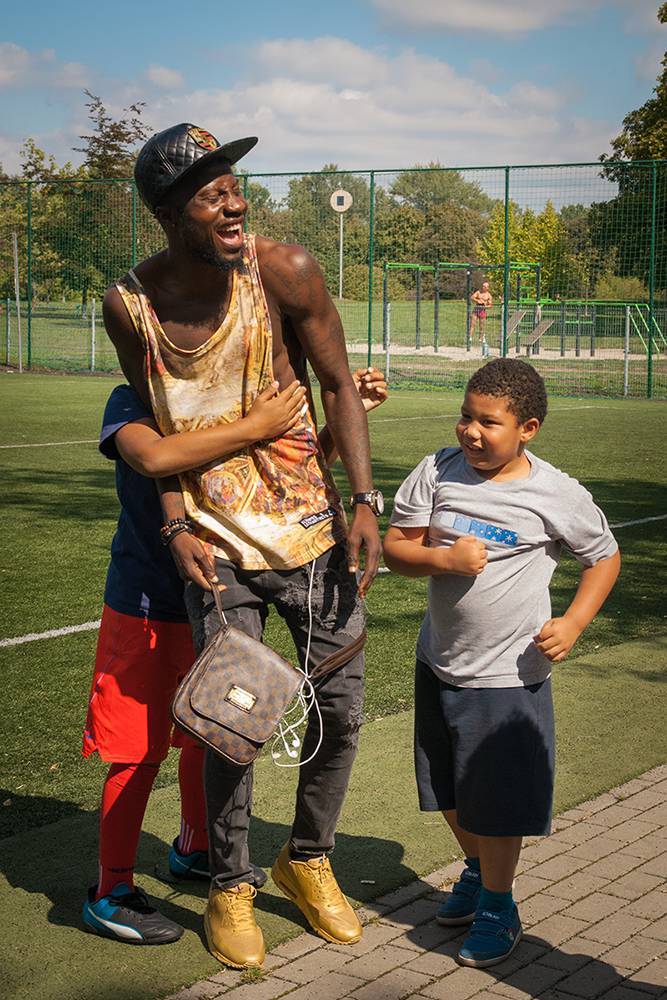 Children of park regulars swarm Olabanji to take the ball away from him during a game in the park. Most of the kids are enrolled in local youth academies and, like their fathers, dream of becoming professional footballers. Warsaw, Summer 2016. (Photo Paweł Banaś)